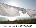white clean sheets outdoors.... | Shutterstock . vector #392546449