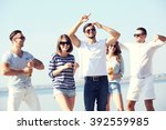 young people with beer on the... | Shutterstock . vector #392559985