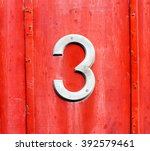 White Number 3 Sign On A Red...
