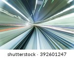 subway tunnel with motion blur... | Shutterstock . vector #392601247
