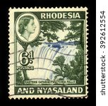 Small photo of RHODESIA AND NYASALAND - CIRCA 1959: A stamp printed in Federation of Rhodesia and Nyasaland, also known as the Central African Federation (CAF) shows Queen Elizabeth II and Victoria Falls, circa 1959