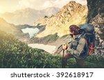 man traveler with backpack... | Shutterstock . vector #392618917
