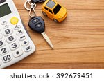 car key with calculator on wood ... | Shutterstock . vector #392679451