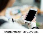 woman holding the blank screen... | Shutterstock . vector #392699281