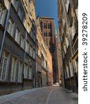 Narrow historic street in Gdansk, overlooking the St. Mary's Basilica, Poland. - stock photo