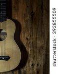 Small photo of Instrument ukulele and background wood