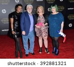 "Small photo of LOS ANGELES, CA - DECEMBER 14, 2015: Filmmaker George Lucas & wife Mellody Hobson & daughters Amanda Lucas & Katie Lucas at the world premiere of ""Star Wars: The Force Awakens"" on Hollywood Boulevard"