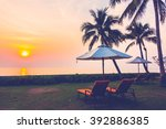 empty umbrella and chair on the ... | Shutterstock . vector #392886385