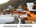 traditional alpine cabins in... | Shutterstock . vector #392988481