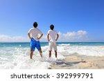 men on a tropical beach  | Shutterstock . vector #392999791