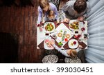 family of four having meal at a ... | Shutterstock . vector #393030451