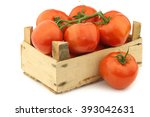 fresh tomatoes in a wooden... | Shutterstock . vector #393042631