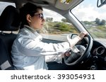 beautiful young woman driving a ... | Shutterstock . vector #393054931