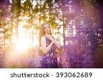 beautiful girl in a field of... | Shutterstock . vector #393062689