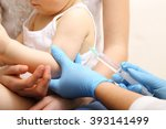 Small photo of Doctor administering vaccination to a child