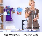young fashion designer working... | Shutterstock . vector #393194935