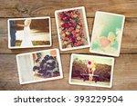 Small photo of Instant photo album of remembrance and nostalgia in wedding and honeymoon on wood table. paper photo of film camera - vintage and retro style