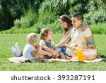 happy young family of four... | Shutterstock . vector #393287191