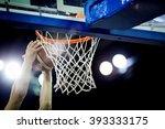 Basketball Going Through The...