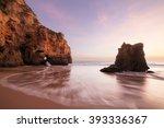 sunset at rocky coastline of... | Shutterstock . vector #393336367