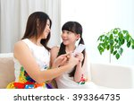 asian mother and daughter... | Shutterstock . vector #393364735