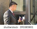mature businessman holding... | Shutterstock . vector #393385801