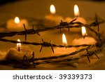 burning candles in barbed wire  ... | Shutterstock . vector #39339373
