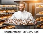 handsome baker in uniform... | Shutterstock . vector #393397735