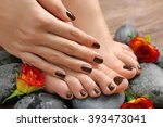 manicured female feet and hand... | Shutterstock . vector #393473041