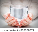 a glass of clean mineral water... | Shutterstock . vector #393500374