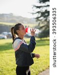 young woman drinking water... | Shutterstock . vector #393506335