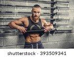 bearded muscular man in a grey... | Shutterstock . vector #393509341