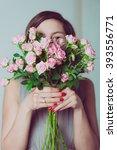 cute bridesmaid hiding behind a ... | Shutterstock . vector #393556771