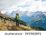 man tourist walking the... | Shutterstock . vector #393583891