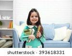 little girl with green back... | Shutterstock . vector #393618331