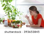 young woman drinking water near ... | Shutterstock . vector #393653845