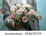 bride holding a beautiful... | Shutterstock . vector #393670759