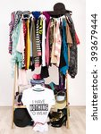 many clothes on the rack with a ... | Shutterstock . vector #393679444
