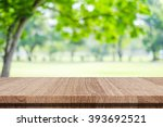 Stock photo nature background wood table for food and product display over blur green tree garden blur park 393692521