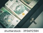 Polish Zloty Cash Money in the Cash Safe Box. Polish One Hundred Zloty Banknotes. - stock photo