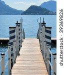 Wooden pier in Menaggio, lake Como, Italy - stock photo