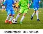 young boys playing youth soccer ... | Shutterstock . vector #393704335