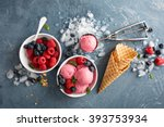 Raspberry ice cream in white bowl overhead shot