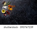 herbs and spices over black... | Shutterstock . vector #393767239