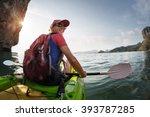 Woman Paddling The Sea Kayak I...