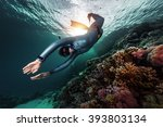 free diver swimming underwater... | Shutterstock . vector #393803134