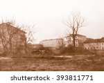 Small photo of blurred Vintage looking Rural urban fringe landscape between town and country in Northern Italy - Vintage looking grainy black and white film in the style of neorealism