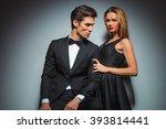 sensual couple in black posing... | Shutterstock . vector #393814441