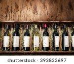 wine bottles on the wooden... | Shutterstock . vector #393822697