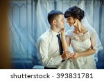 happy beautiful newlyweds | Shutterstock . vector #393831781